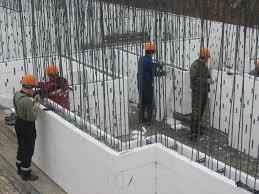 Стена дома из несъемной оплубки